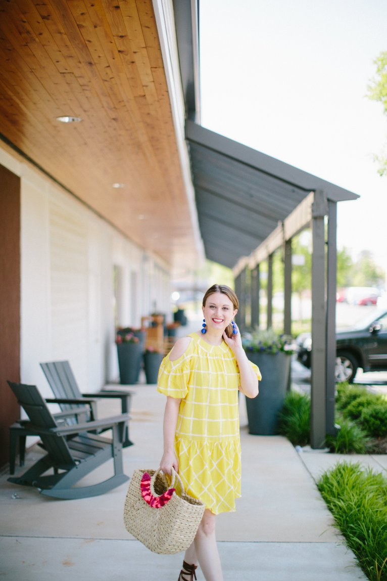 A bright and fun yellow short dress for summer by Fashion Blogger Maggie Kern of Polished Closets