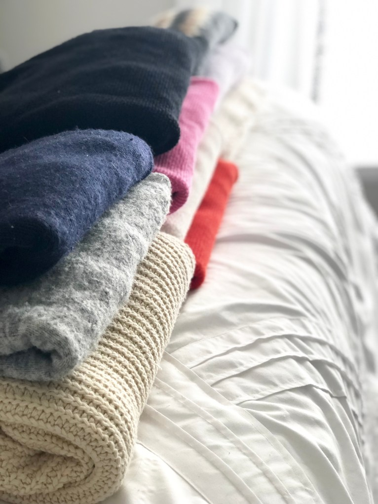 A Step-by-Step Guide to Organizing your Sweaters by lifestyle blogger Maggie Kern of Polished Closets.
