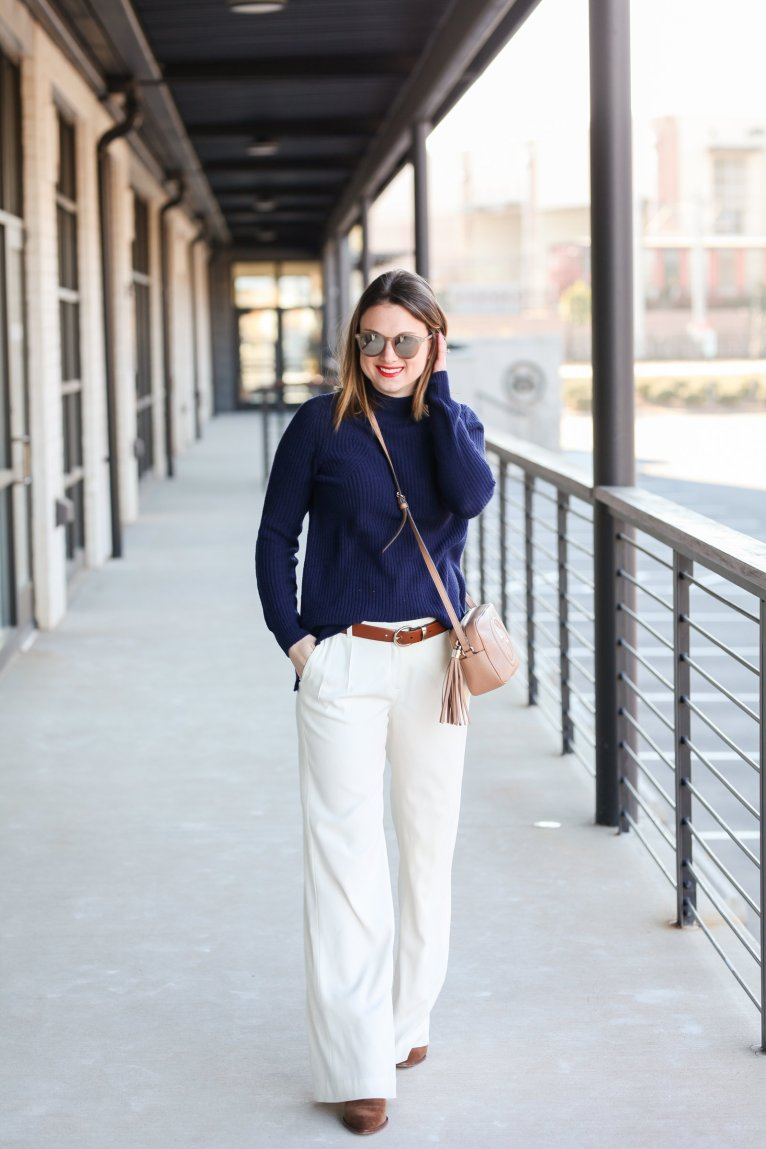 How to Wear Winter White Wide Leg Trousers by fashion blogger Maggie Kern of Polished Closets.