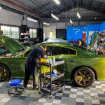 This Dodge charger is being paint corrected for maximum glossy paint with no swirl marks
