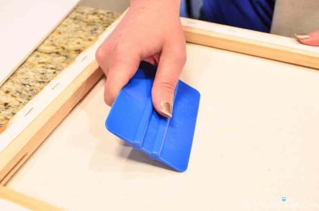 Applying vinyl to canvas