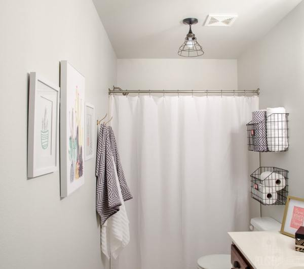 Budget Bathroom Makeover - This guest bathroom went from boring beige to organized modern industrial style in one weekend for under $300.