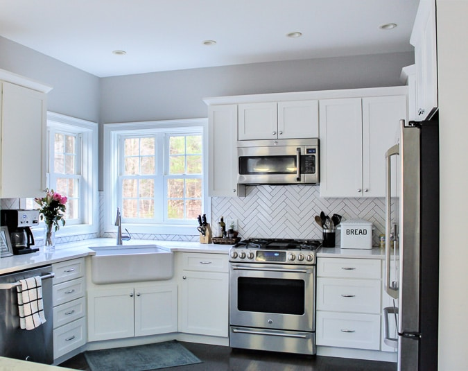 White modern farmhouse kitchen - can you believe this used to be a dark, oak kitchen?
