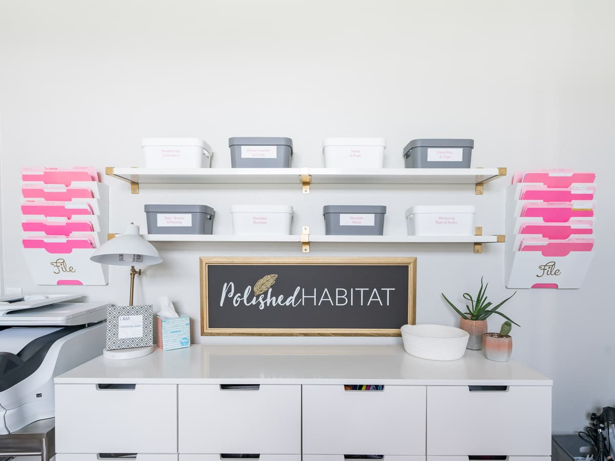 Open shelves with organized bins in white office