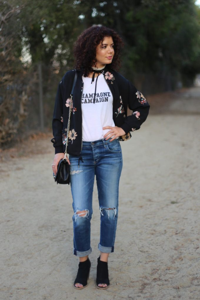Target floral bomber jacket with graphic tee and jeans