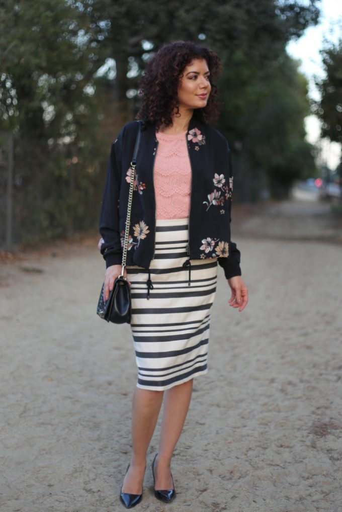 floral bomber jacket with striped skirt and lace tee