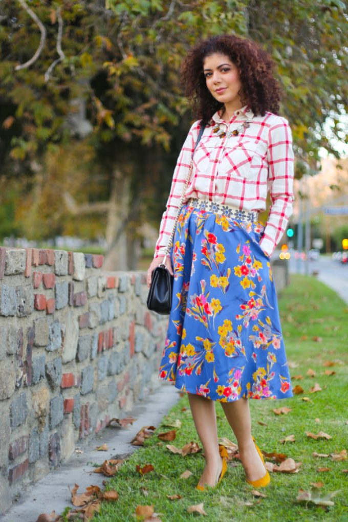 Pattern mixing red jcrew plai with floral anthropologie skirt, demonstrating mustard yellow and red color combination