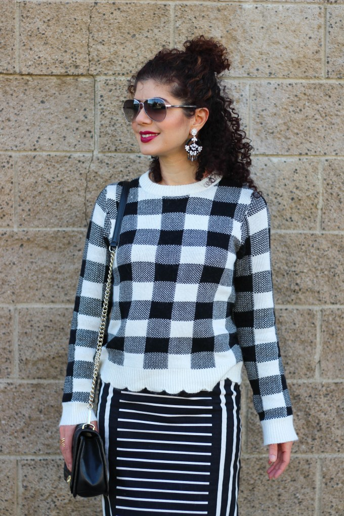 Blogger polished whimsy in buffalo check sweater and striped skirt with baublebar Chiquita earrings