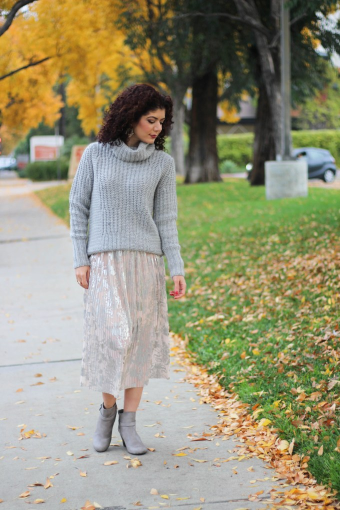 Polished whimsy in skirt with turtleneck sweater and wedge booties