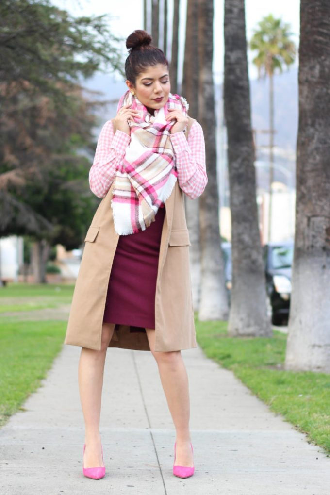 Everyday style blogger polished whimsy wearing burgundy j crew pencil skirt, camel long vest, pink plaid blanket scarf and pink Kate spade pumps.