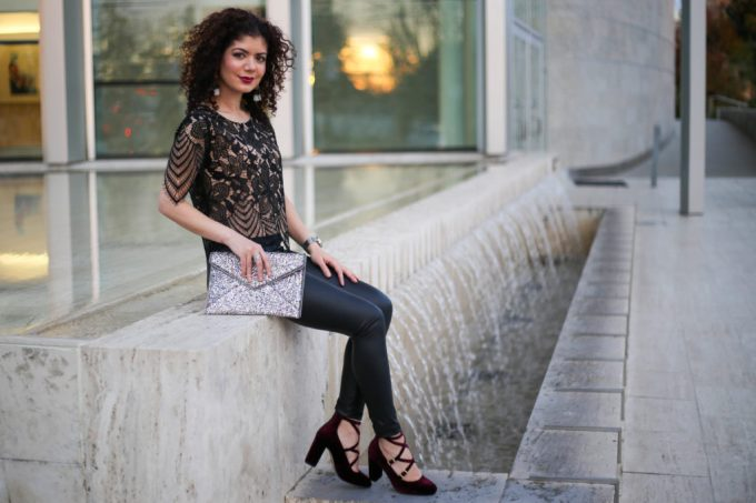 Polished whimsy in leather leggings and lace top