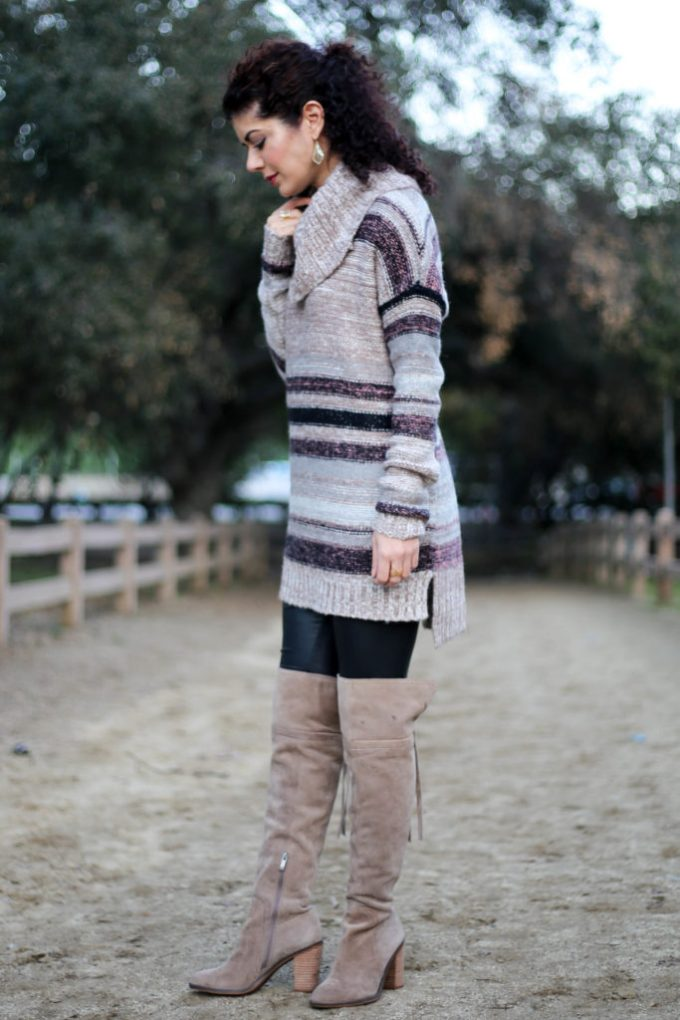 Polished whimsy wearing leather leggings with a sweater and over the knee boots