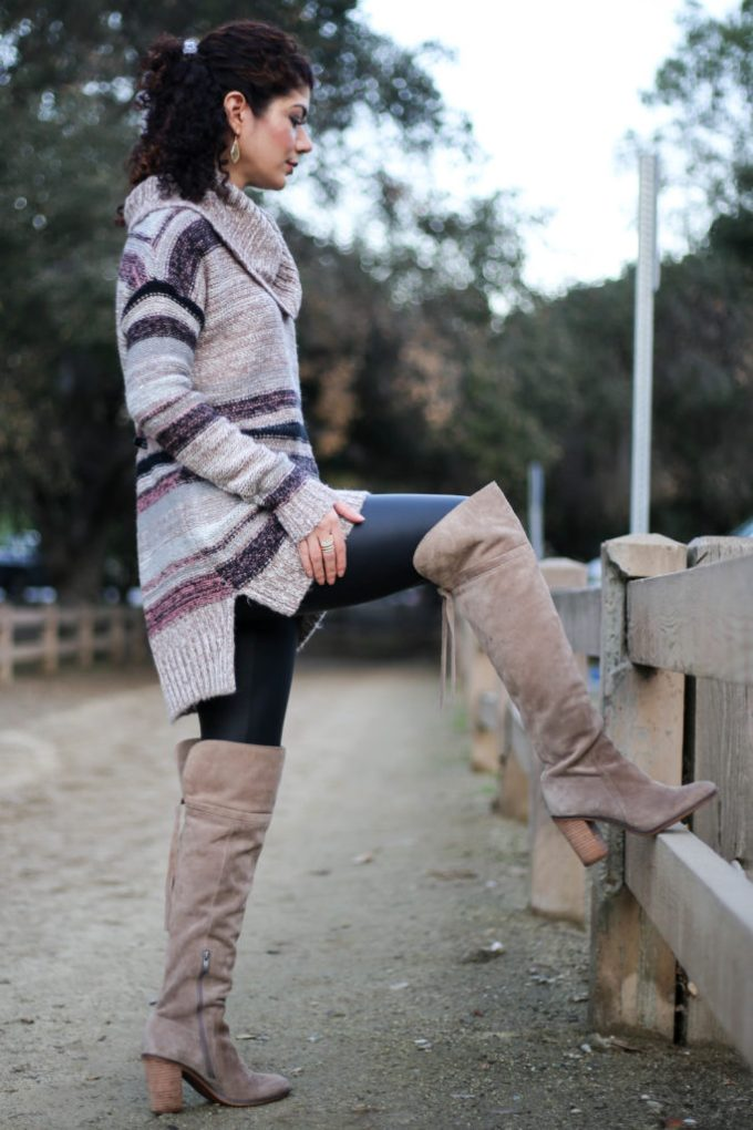 Polished whimsy wearing leather leggings and over the knee boots
