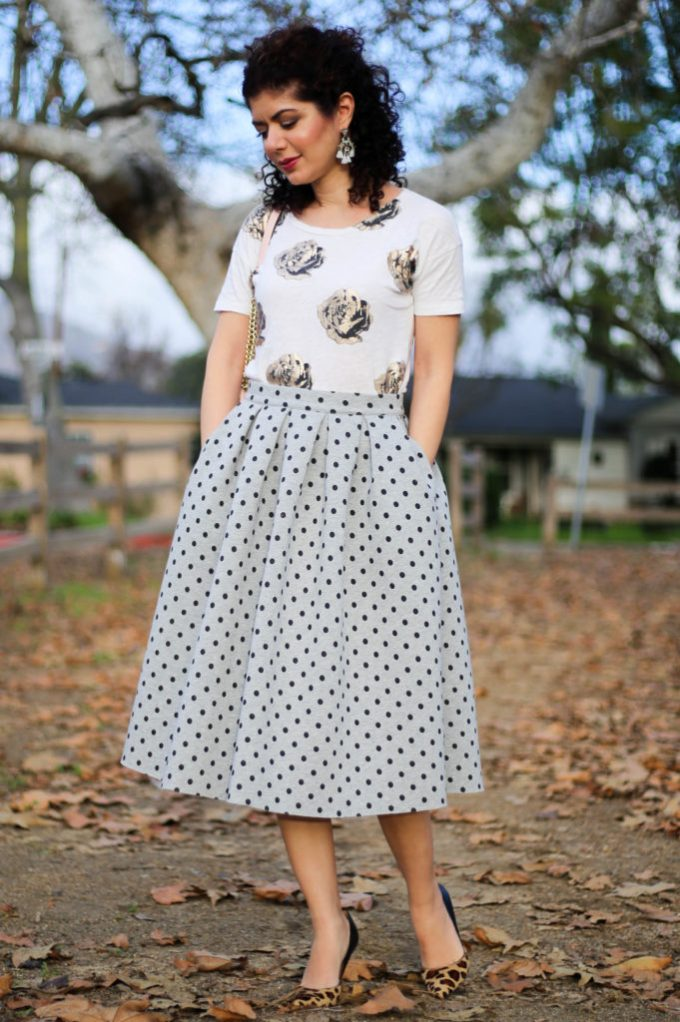 everyday style blogger polished whimsy wearing a pattern mixing outfit with floral print shirt, polka dot midi skirt, and leopard print heels