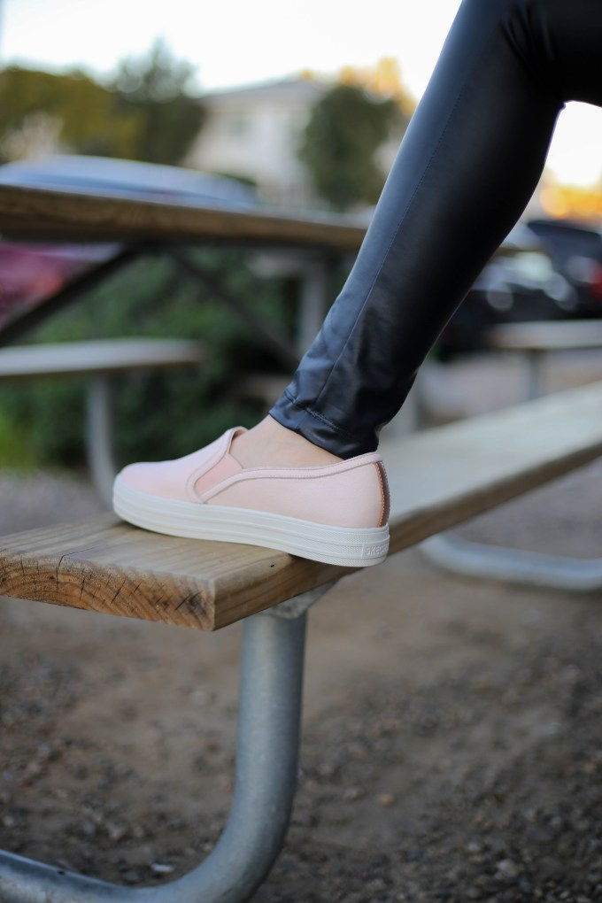 Polished whimsy in leather leggings and pink skechers slip on shoes