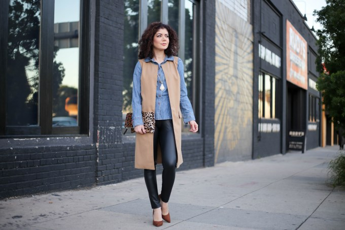 Polished whimsy in leather leggings, chambray shirt, long vest and leopard print clutch