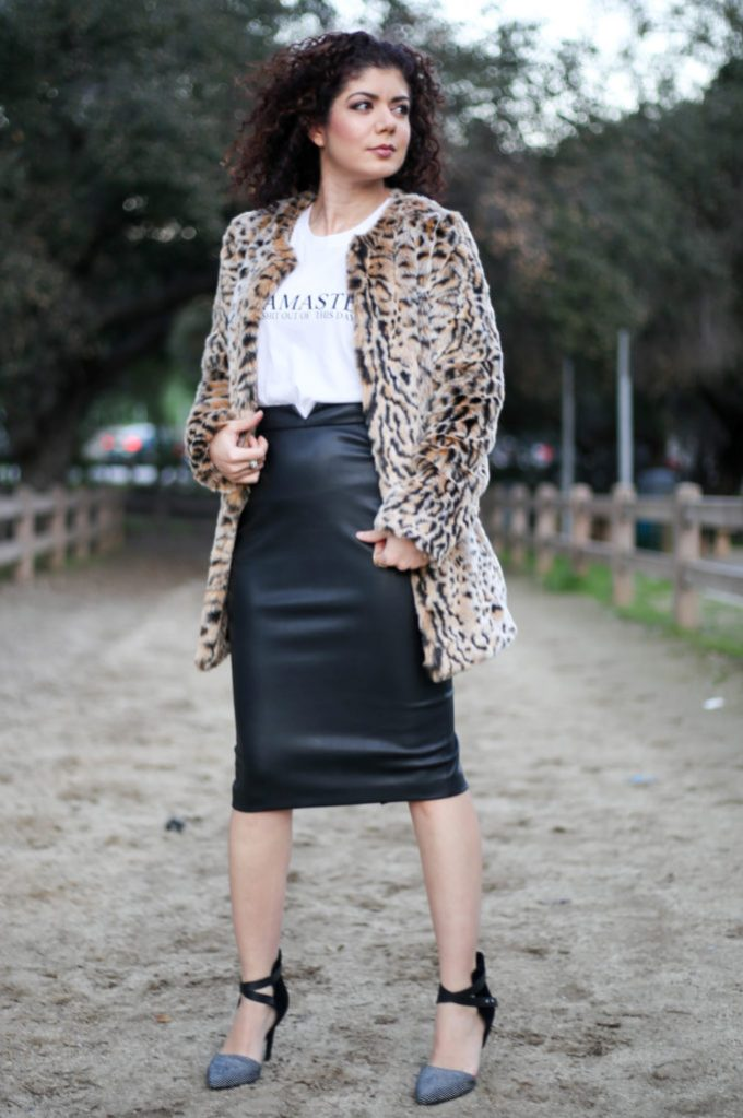 Fashion blogger polished whimsy styling a graphic tee for a night out with a leather pencil skirt, leopard print fur coat and sexy heels