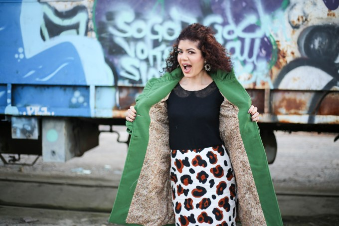 Polished whimsy in leopard print skirt and green colorful coat