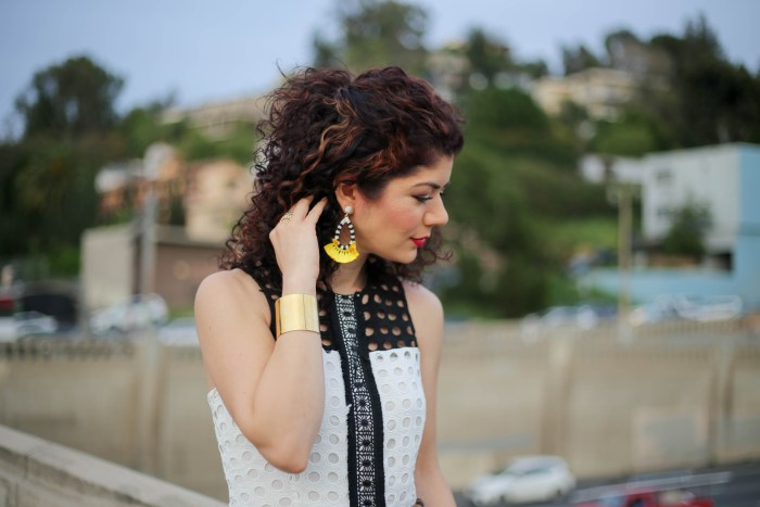 Everyday style blogger wearing devlin color block eyelet lace dress and baublebar yellow earrings for spring transition outfit