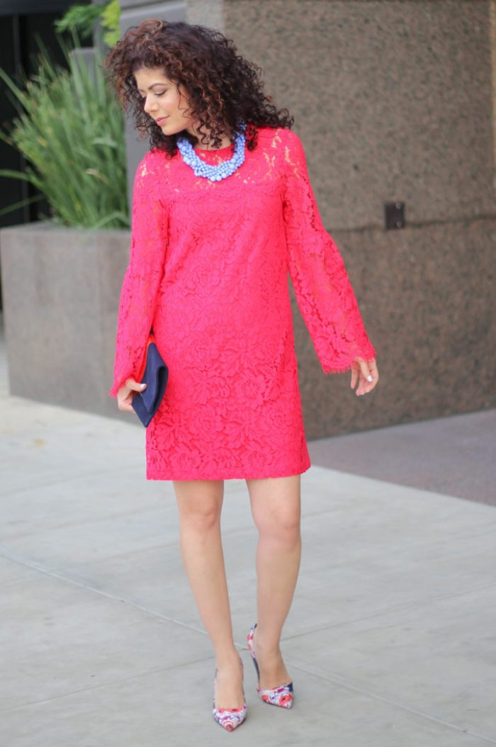 everyday style blogger polished whimsy wearing devlin pink lace bell sleeve dress with clare v blue and gold stripe clutch, kate spade floral pumps, baublebar blue necklace and rose gold watch and bracelets for spring transition outfit
