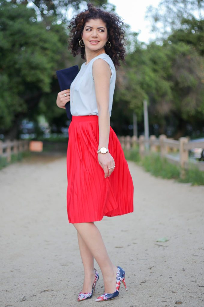 Everyday style blogger polished whimsy wearing examples of light blue and red outfits: baby blue loft blouse and red HM pleated skirt and floral pumps