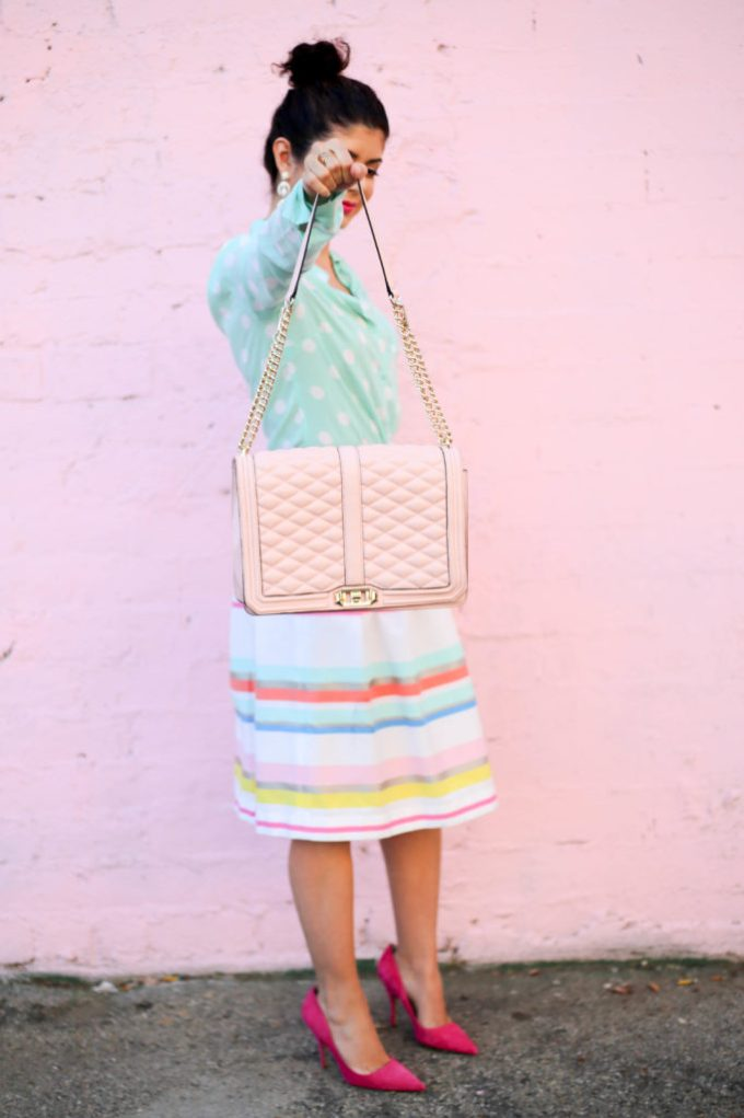 Pattern mixing polka dot blouse with colorful striped skirt