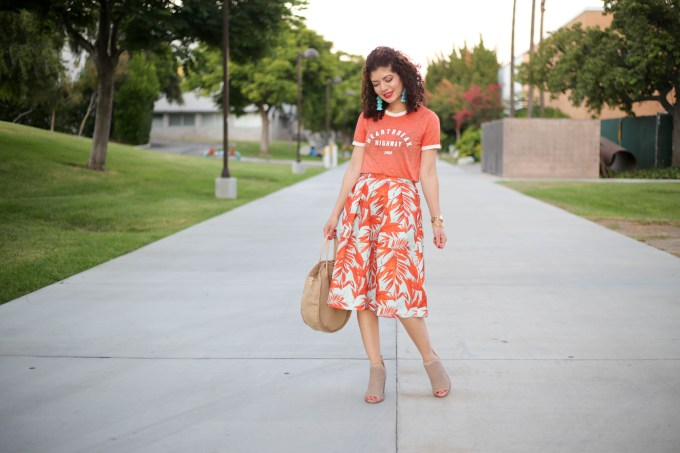 H&M palm tree print skirt with a graphic tee