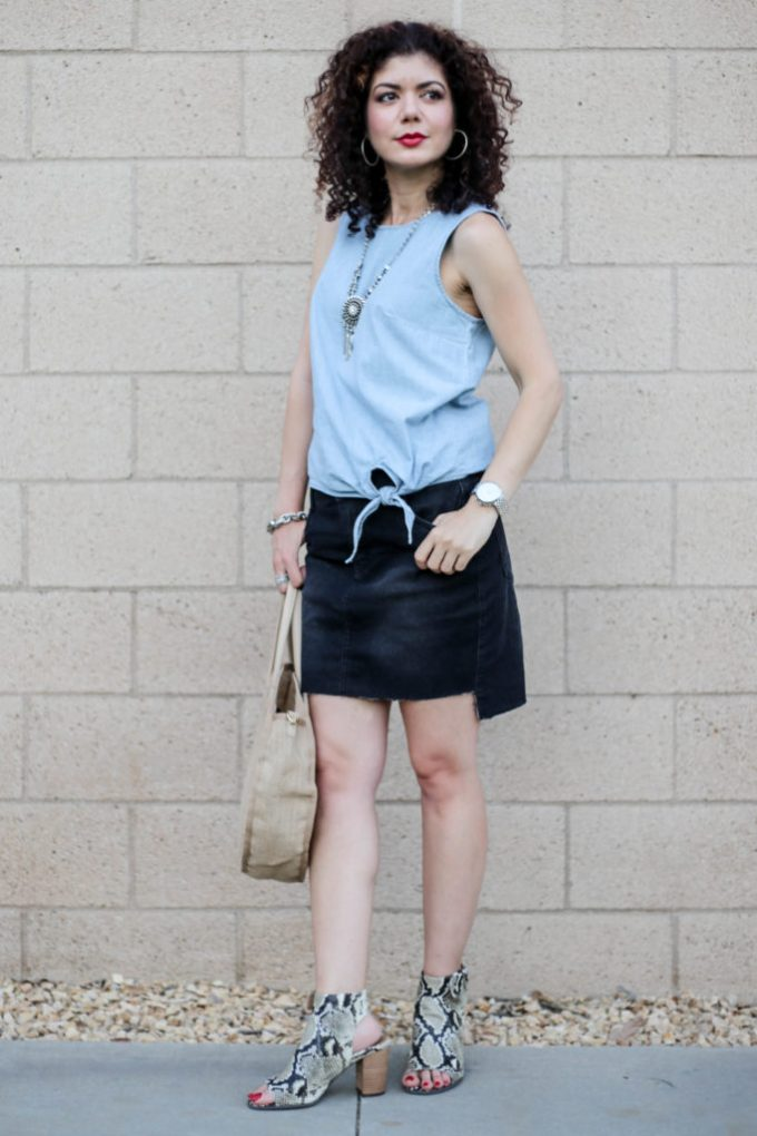 Denim on denim with J Crew chambray tie waist top, black distressed denim skirt and Vionic shoes Blakely booties in natural snakeskin