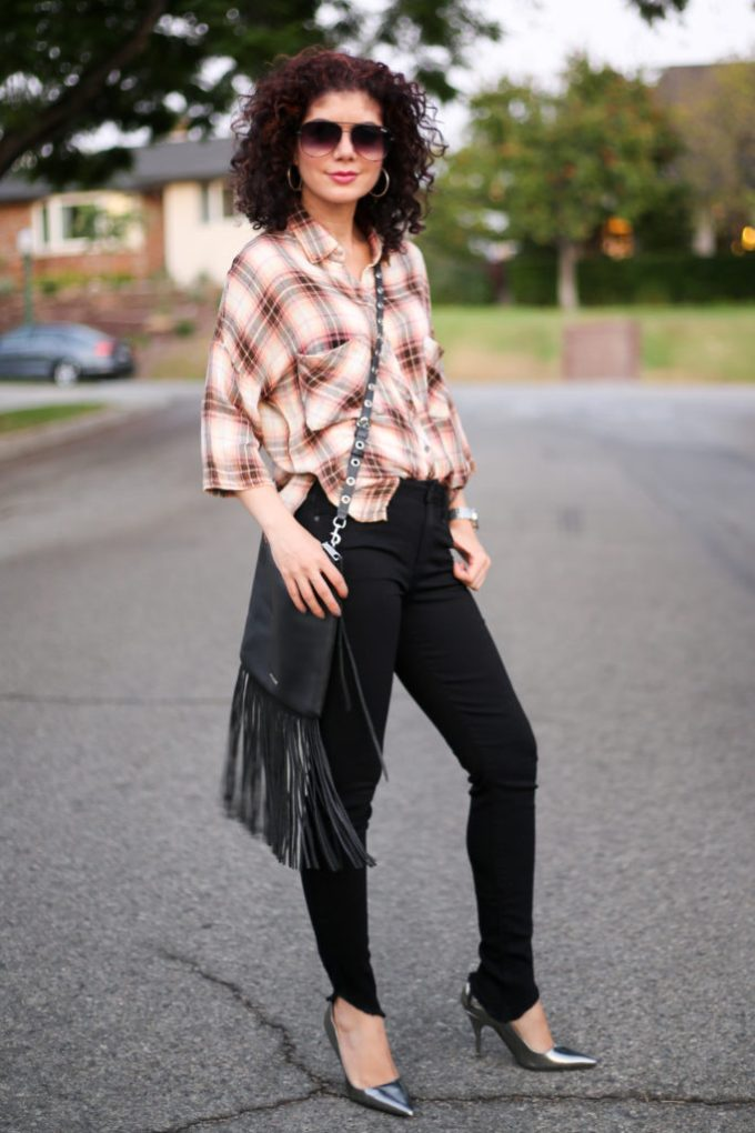Plaid shirt outfit for fall with black asymmetrical hem jeans and silver pumps