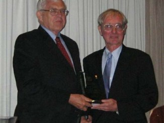 Pictured L-R: Dr. Charles F. Merbs receiving Distinguished Service Award from Pres. Ted Mirecki