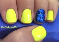Neon Yellow Nails With a Blue Glitter Accent Nail ...