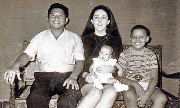 ** FILE ** This 1970's photo provided by the presidential campaign of Sen. Barack Obama, D-Ill., shows the presidential hopeful, Obama, 9, right, with his mother Ann Dunham, center, his Indonesian step-father Lolo Soetoro, and his less than one-year-old sister Maya Soetoro in Jakarta, Indonesia. (AP Photo/Obama Presidential Campaign) Obama Profile Obama Profile