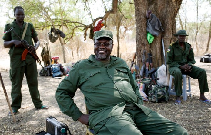 South Sudan's rebel leader Riek Machar sits near his men in a rebel-controlled territory in Jonglei State, South Sudan January 31, 2014. REUTERS/Goran Tomasevic/File Photo