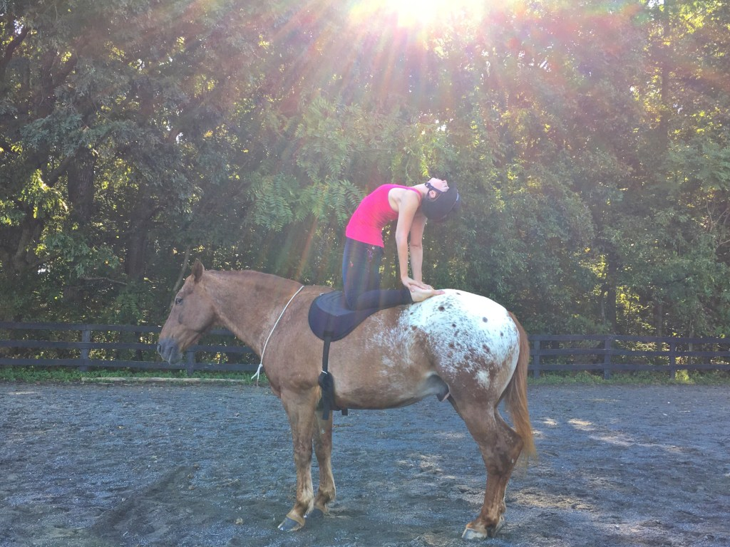 Angela doing yoga on her horse Snowy