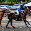 Aiken-Polo-Clubs-Summer-Kneece-running-with-the-ball-just-out-of-reach-of-Maryland-Polo-Clubs-Sierra-Blevins.-©Larry-Johnson