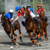 Maryland-Polo-Clubs-Jordan-Peterson-playing-the-ball-with-Aiken-Polo-Clubs-Reagan-Leitner-defending-on-the-nearside.-©Larry-Johnson