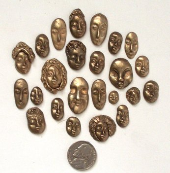 bronze cast faces