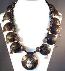 polymer clay bead face and silver necklace