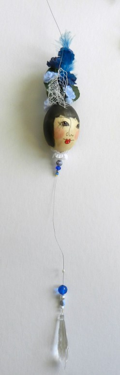 eggshell ladies made with liquid polymer clay, silk flowers, and a lead crystal prism with beads