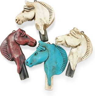 Joan Tayler's horse whistles make manly pendants on PolymerClayDaily