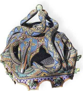 Snakes form the main theme on Jon Anderson's latest sculpture on PolymerClayDaily.com