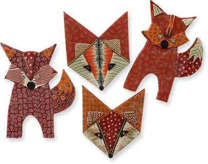 Laurel Swetnam hangs scrap foxes on the tree on PolymerClayDaily.com