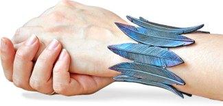 Natalya Aleksandrova's feathers glow with dark, magic on PolymerClayDaily.com
