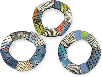 Circle pins from Olympic experimenter Nikolina Otrzan on PolymerClayDaily.com