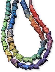 Tanya Mayorova makes beads in colors that flow and shapes that snuggle on PolymerClayDaily.com