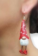 Dani Kirova wears a Santa gnome on her ears on PolymerClayDaily.com
