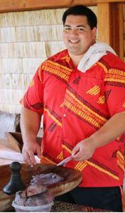 Volunteer Spencer Mauaihelps make fresh poi inthe PCC's Hawaiian Village