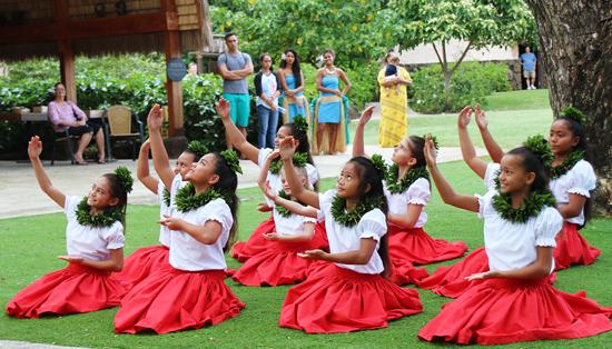 Keiki or children dancers from the Laie-based Hālau Hula o Kekela, led by kumu hula Kela Miller, perform a sitting hula on January 17, 2015, in the PCC's Hawaiian Village. (PCC photos by Mike Foley)