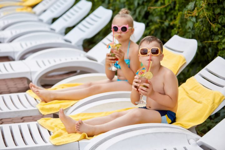 kids on white chaise lounge chairs