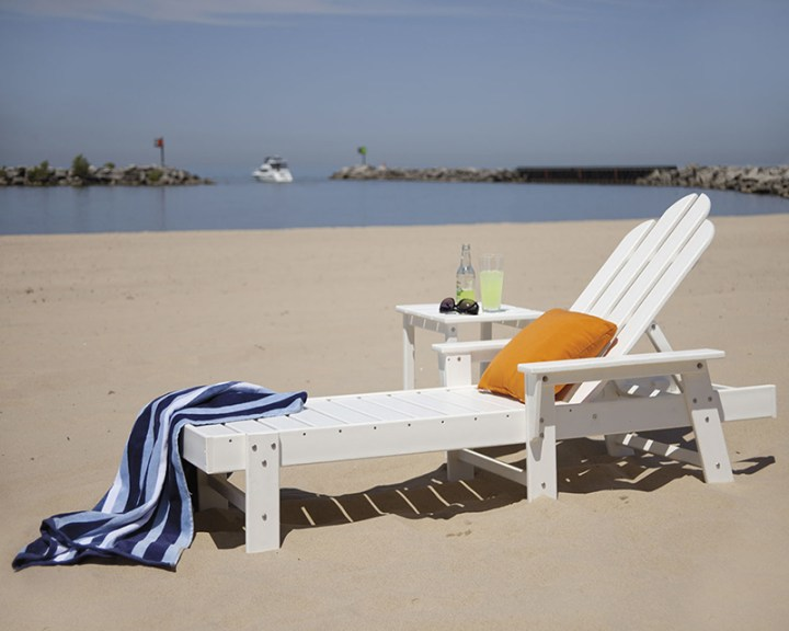white polywood chaise lounge on beach